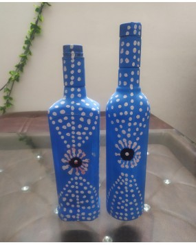 painted glass bottles and vases wrapped in Jute